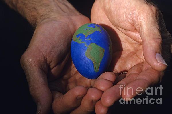 Man Holding Earth Egg Print by Jim Corwin