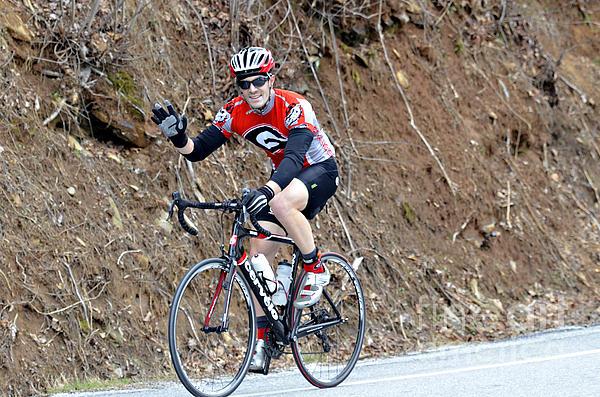 Man Riding Bike In A Race Print by Susan Leggett