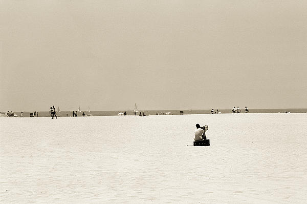 Man Sitting On A Beach Playing His Horn Print by Stephen Spiller