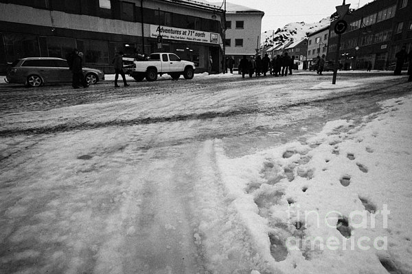 melting ice and snow on street surface holmen Honningsvag finnmark norway europe Print by Joe Fox