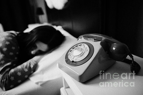 Old Fashioned Gpo Bt Phone On Bedside Table Of Early Twenties Woman In Bed In A Bedroom Print by Joe Fox