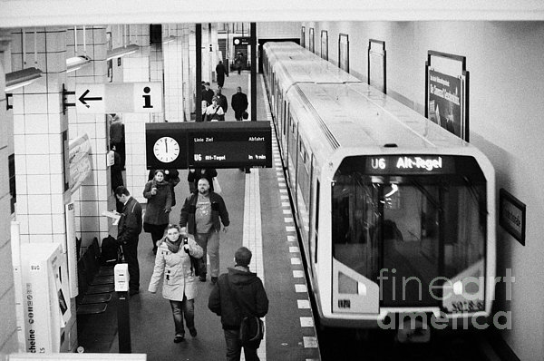 passengers on ubahn train platform as train leaves Friedrichstrasse u-bahn station Berlin Germany Print by Joe Fox