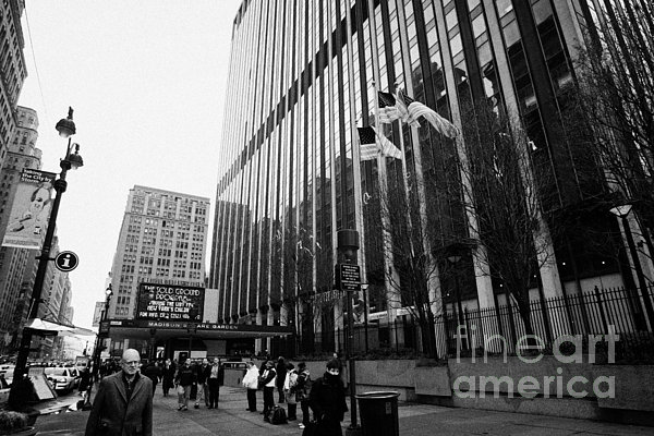 people on the sidewalk outside madison square garden with US flags flying new york city Print by Joe Fox