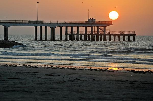 Pier At Dawn Print by John Collins