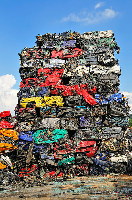 Matthias Hauser - Pile of scrap cars on a wrecking yard