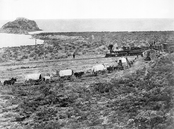 Railroad Meets Wagon Train Print by Underwood Archives