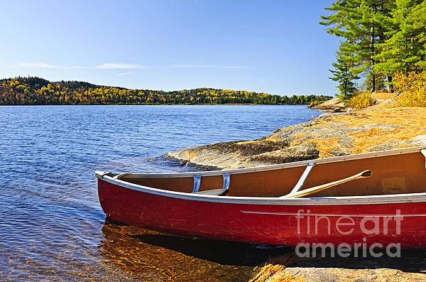 Red Canoe On Shore Print by Elena Elisseeva
