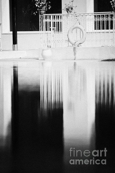 Red Lifebelt And Reflection In Still Blue Swimming Pool In Resort Hotel Hammamet Tunisia Print by Joe Fox