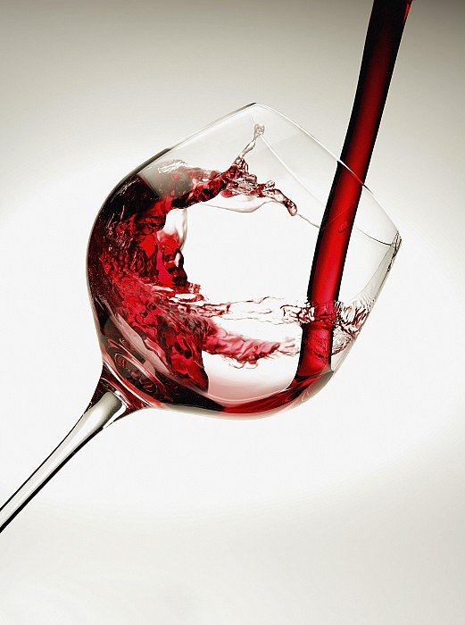 Red Wine Pouring Into A Glass Print by Richard Desmarais