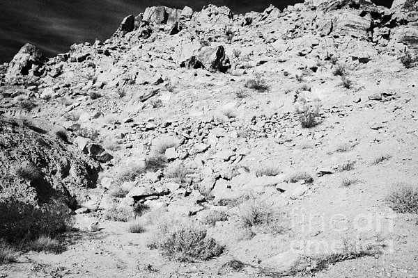 Rocks Forming Support For The Old Arrowhead Trail Road Valley Of Fire State Park Nevada Usa Print by Joe Fox