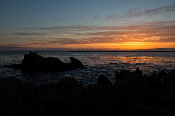 Rocky Sunset At Corona Del Mar Print by John Daly