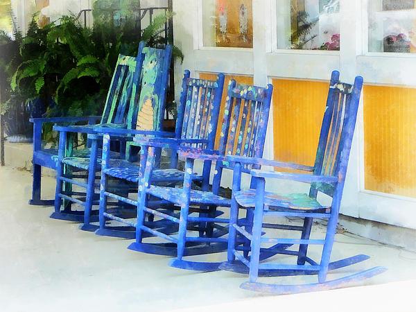 Row Of Blue Rocking Chairs Print by Susan Savad