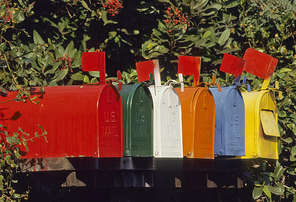Row Of Colorful Mailboxes Print by David Litschel