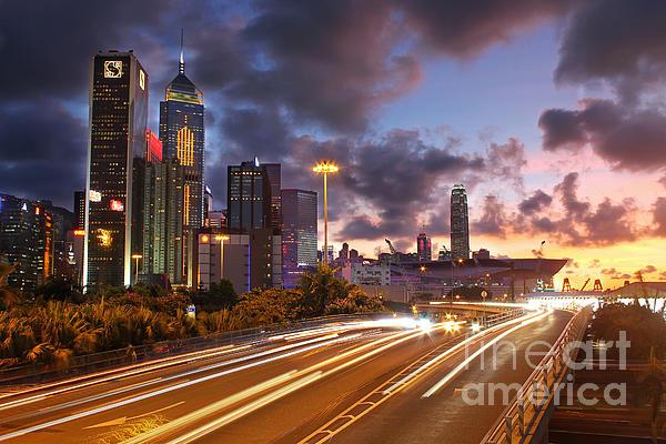 Rush Hour During Sunset In Hong Kong Print by Lars Ruecker
