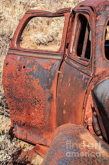 Rusty Doors Print by Sue Smith