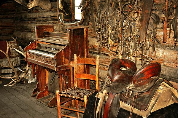 Saddle And Piano Print by Marty Koch
