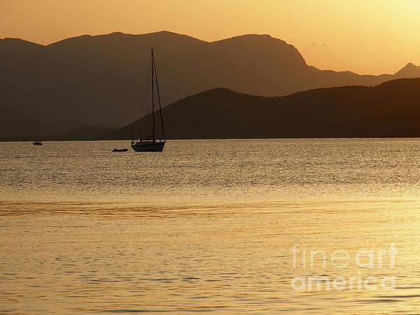 Sailboat At Sunset Print by Sophie Vigneault
