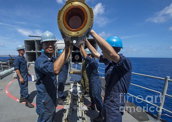 Sailors Load Rim-7 Sea Sparrow Missiles Print by Stocktrek Images