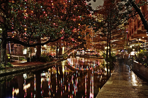 Alan Tonnesen - San Antonio riverwalk decorated with shiny lights at night refle