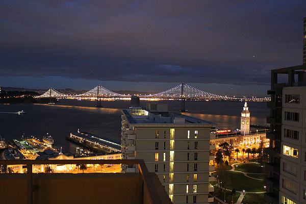 San Francisco Embarccadero City Lights With Bay Bridge Print by Ron McMath