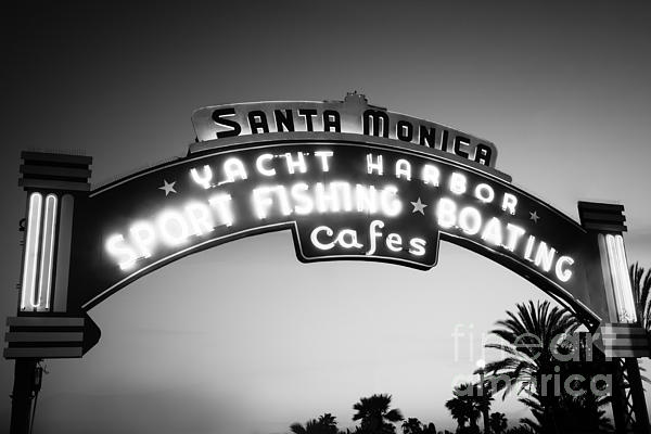 Santa Monica Pier Sign In Black And White Print by Paul Velgos