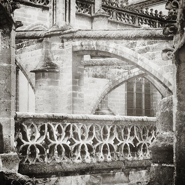 Seville Cathedral Buttresses Black And White Print by Angela Bonilla