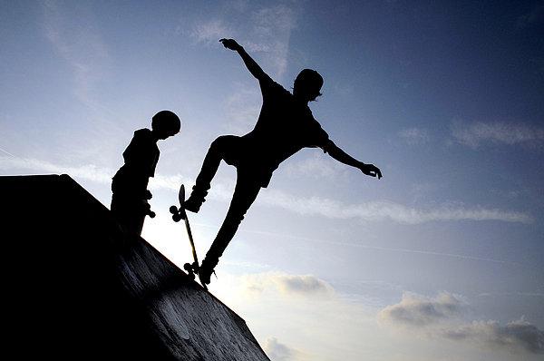 Skateboarders Print by Fabrizio Troiani