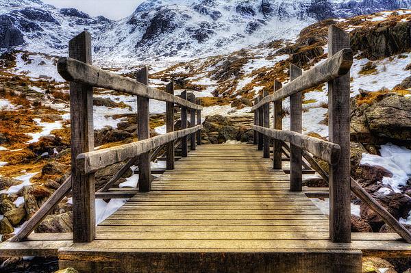 Snowy Footbridge Print by Ian Mitchell
