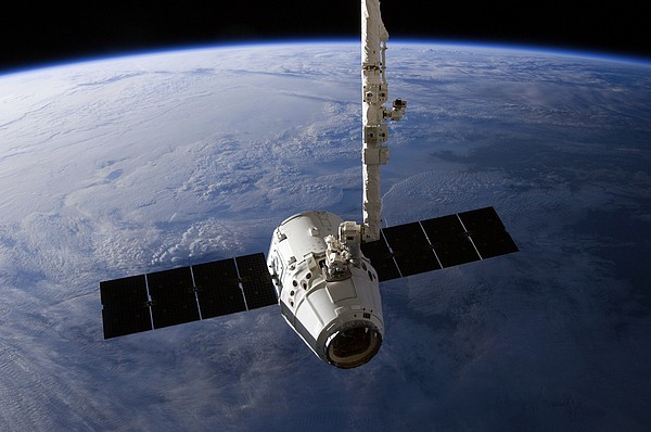 Spacex Dragon Capsule At The Iss Print by Science Photo Library