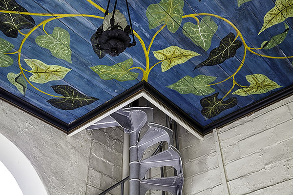 Spiral Stairs And Mural Print by Lynn Palmer