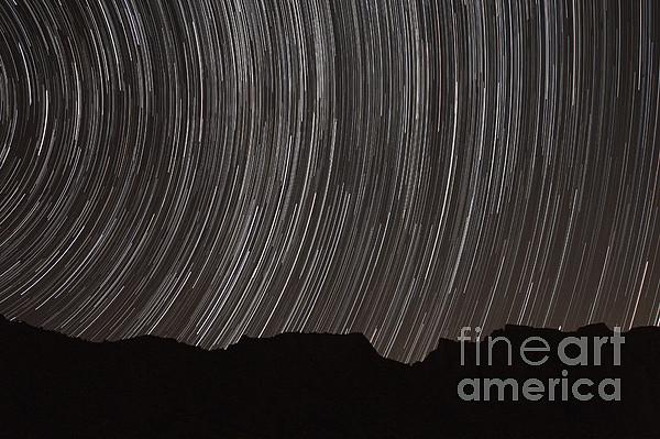 Star Trails Above A Valley Print by Amin Jamshidi