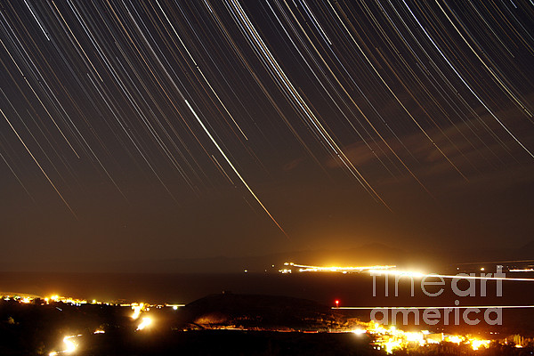Star Trails Above A Village Print by Amin Jamshidi