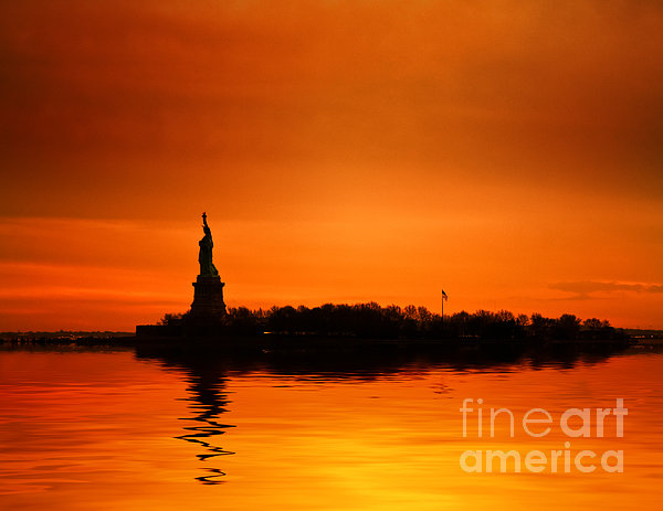 Statue Of Liberty At Sunset Print by John Farnan