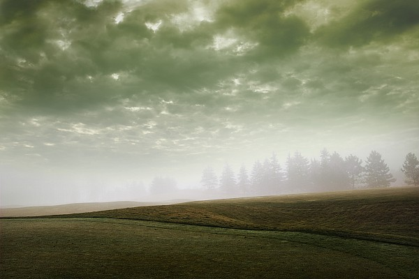 Storm Clouds And Foggy Hills Print by Vast Photography