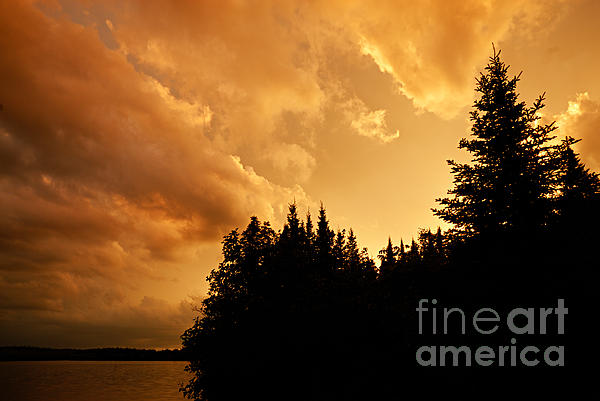 Storm Clouds At Sunset Print by Larry Ricker
