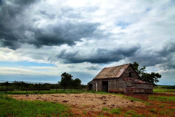 Storms Coming Over Barn Print by Toni Hopper
