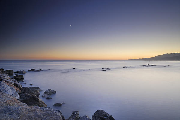 the Moon over the sea Print by Guido Montanes Castillo