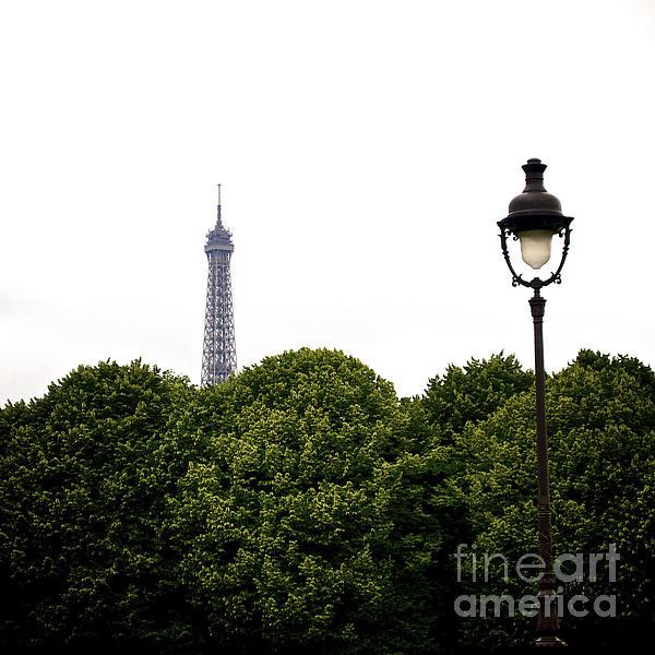 Top Of The Eiffel Tower And Street Lamp. Paris.france. Print by Bernard Jaubert