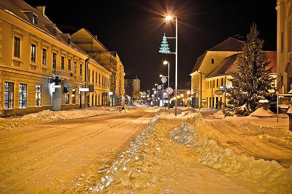 Town In Deep Snow On Christmas  Print by Dalibor Brlek