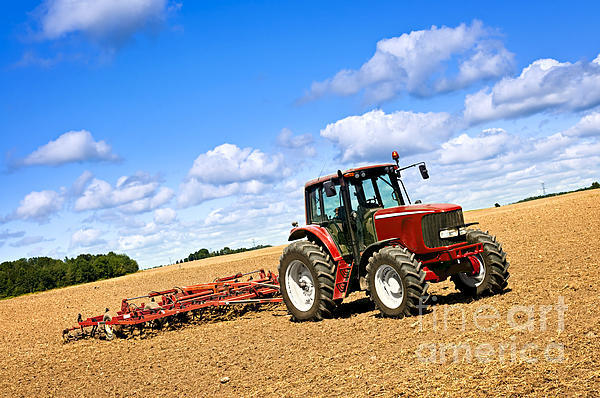 Tractor In Plowed Farm Field Print by Elena Elisseeva
