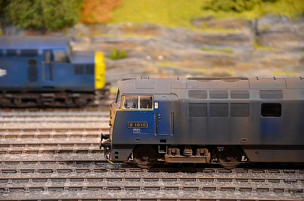 Two Yellow And Blue Model Train Engines Print by Imran Ahmed