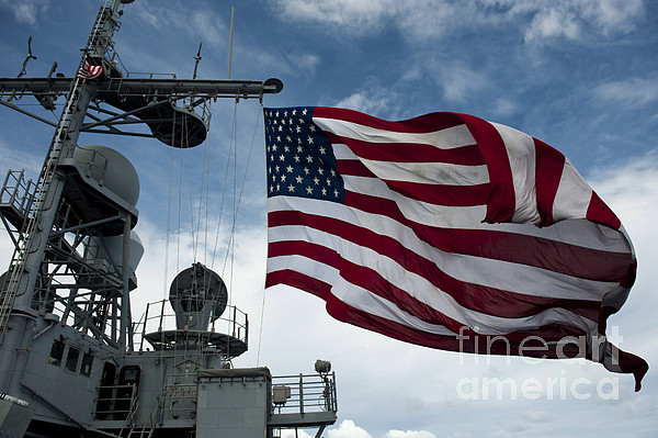 Uss Cowpens Flies A Large American Flag Print by Stocktrek Images