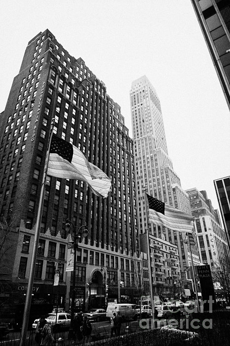 view of pennsylvania bldg nelson tower and US flags flying on 34th street new york city Print by Joe Fox