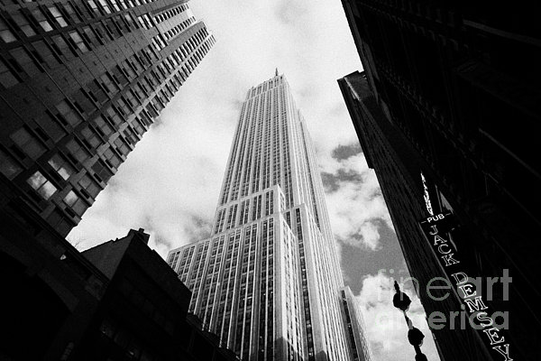 View Of The Empire State Building And Surrounding Buildings And Cloudy Sky West 33rd Street New York Print by Joe Fox