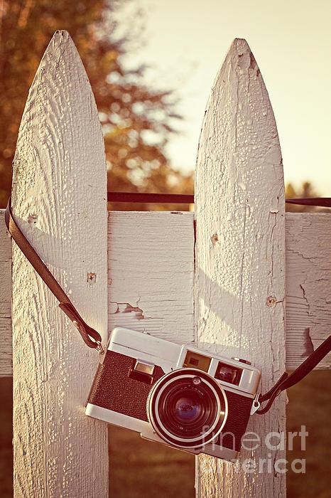 Vintage Film Camera On Picket Fence Print by Edward Fielding