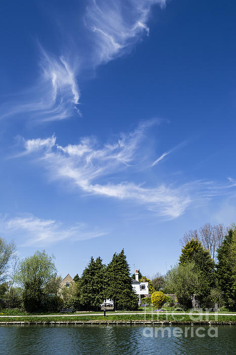 Wispy Clouds Above The River Cam Print by Keith Douglas