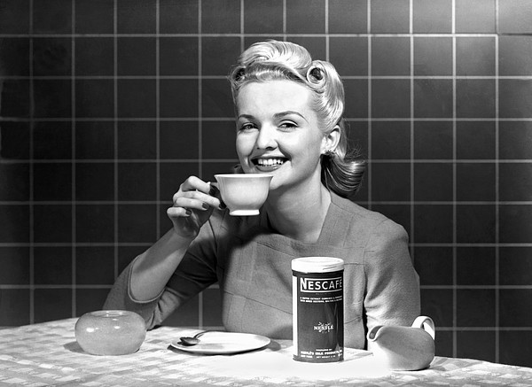 Woman Drinking Nescafe Print by Underwood Archives