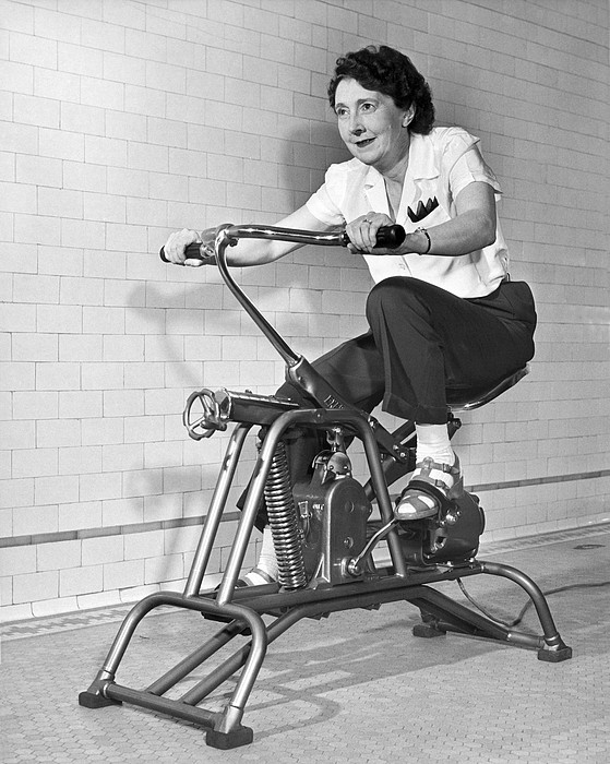 Woman On Exercycle Print by Underwood Archives