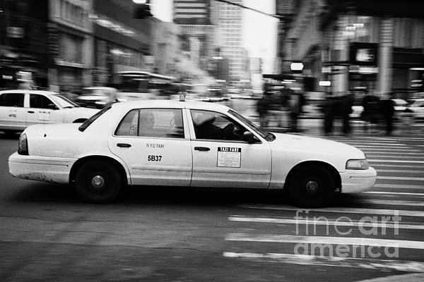 Yellow Cab Blurring Past Crosswalk And Pedestrians New York City Usa Print by Joe Fox