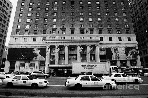 Yellow Cabs Go Past Pennsylvania Hotel On 7th Avenue New York City Usa Print by Joe Fox